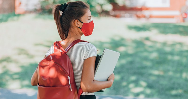 female student wearing mask on campus