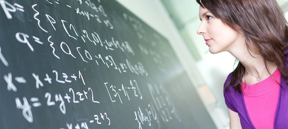 female student at chalkboard